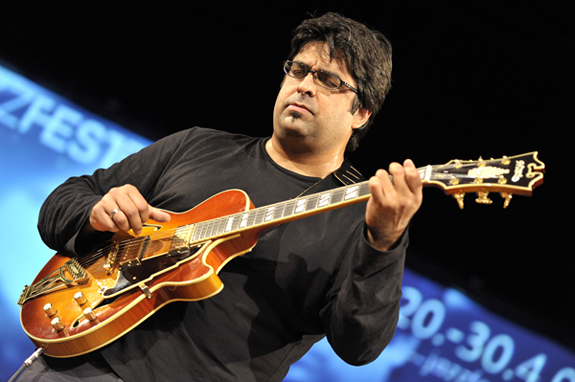 Rez Abbasi playing guitar