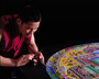 Sand Mandala Monk with chak-pur (sand funnel)