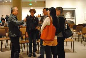 Yun-Fei Ji talks with museum visitors at the Opening Reception of Yun-Fei Ji:  Migrants, Ghosts, and the Dam.