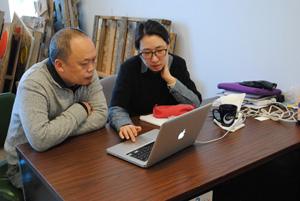 Geuryung Lee, grad student, discusses her work with Artist-in-Residence Yun-Fei Ji.