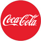 "Coca-Cola logo. A red circle with white, cursive text that reads ""Coca-Cola""."